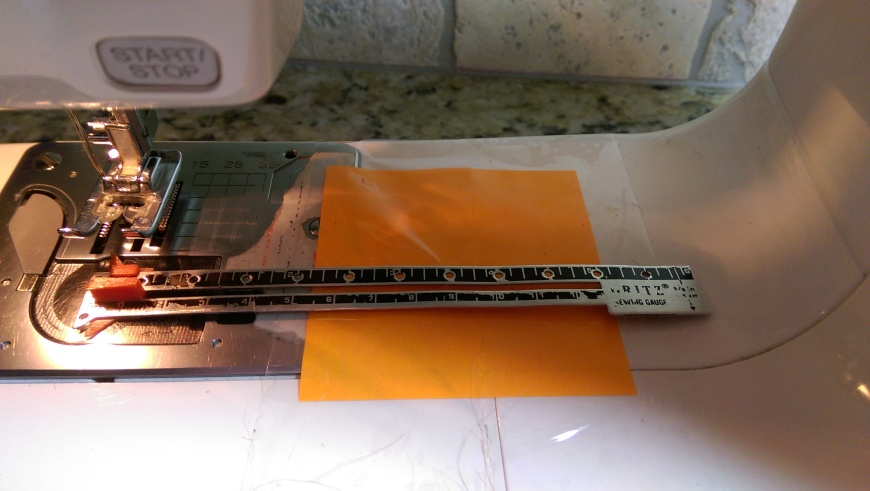 I created a 5-inch hemming guide with a post it note taped to the platform